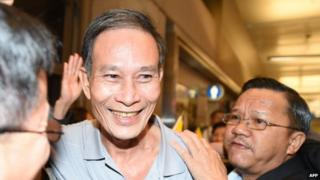 Freed Vietnamese dissident Nguyen Van Hai is greeted upon arrival at Los Angeles International Airport on 21 October 2014 in Los Angeles, California