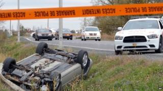 A car is overturned in the ditch in St-Jean-sur-Richelieu, Quebec, on 20 October 2014