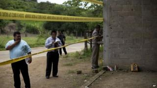 State authorities use crime scene tape to seal off an unfinished warehouse where 22 people were killed on 30 June 2014 (Photo from 3 July 2014)