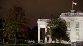 Secret Service officers keep watch over the lawn at the White House