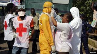 Health workers in Freetown, Sierra Leone, on 14 October 2014