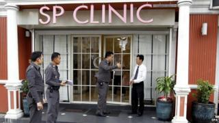 Thai police officers at the beauty treatment clinic in Bangkok
