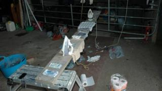 Police found irons, bleach and stolen banknotes stained with dye