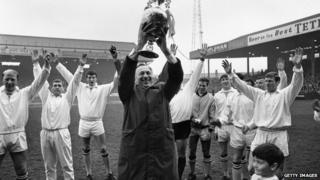 Manchester City Manager, Joe Mercer holds the League Championship trophy aloft after an exhibition match against Bury at Maine Road, Manchester in 1968