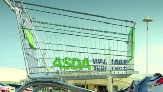 shopping trolley in front of Asda