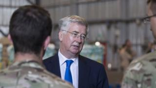 Michael Fallon talking to British soldiers