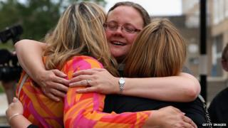 The Rev Dr Hannah Cleugh embraces church members