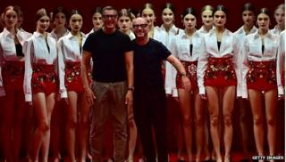 Stefano Gabbana and Domenico Dolce in front of models