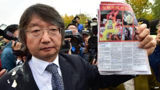 South Korean activist Choi Woo-Won, the main organiser for the balloon launch event, shows an anti-North Korea leaflet after they were blocked by local residents near Imjingak peace park in the border city of Paju, north of Seoul, on October 25,
