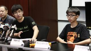 A photo made available 26 October 2014 shows pro-democracy co-leaders (L-R) Benny Tai, Alex Chow and Joshua Wong holding a press conference to announce the holding of a poll or referendum the next day among pro-democracy advocates, in Admiralty district of Hong Kong, China, 25 October 2014