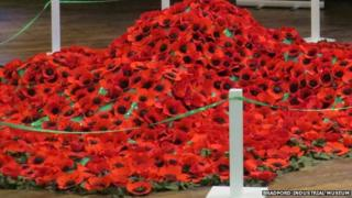 Field of fabric poppies