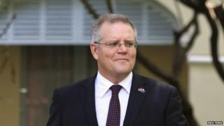 Australia's Immigration Minister Scott Morrison leaves after an interview with Reuters in Phnom Penh 26 September 2014.