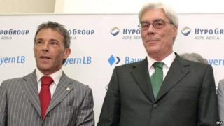Carinthia's governor Joerg Haider (left) and BayernLB CEO Werner Schmidt (right) in May 2007