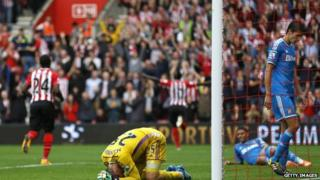 Vito Mannone of Sunderland looks dejected after the eighth goal is scored by Sadio Mane of Southampton during the Premier League match between Southampton and Sunderland at St Mary's Stadium on October 18, 2014