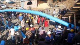 Rescuers in Turkey use pipes to pump out water