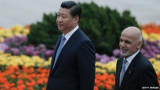 Wooing China: President Ashraf Ghani (r) is greeted by his host, President Xi Jinping