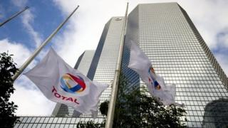 """Total""""s flags are seen at half mast"""