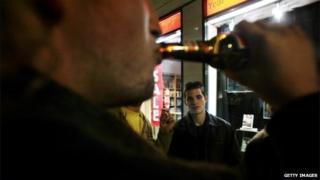Man drinking in the street