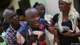 A grieving man in Liberia - October 2014