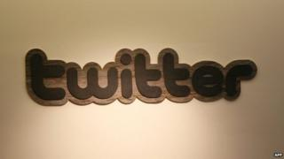In this March 11, 2011 file photo, the Twitter logo is displayed at the entrance of Twitter headquarters in San Francisco, California