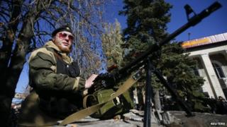 Pro-Russian separatist guards his position near the Kholodnaya Balka mine in Makiyivka, outside Donetsk, eastern Ukraine