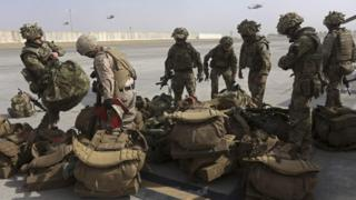 British soldiers arrive at Kandahar air base at the end of operations for US Marines and British combat troops in Helmand