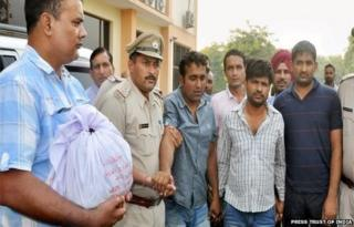 Haryana Police present the Gohana bank heist accused to the media in Sonepat on Thursday.