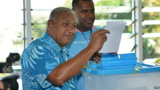 Frank Bainimarama casts his vote in the capital Suva during Fiji's elections - 17 September 2014