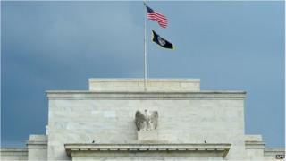 The US flag flaps over the Federal Reserve building in Washington