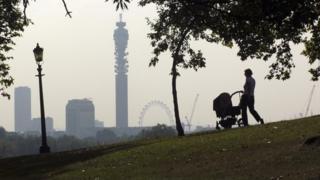Woman with a pram walking in London