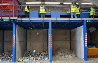 Guernsey Recycling sorting items left out for kerbside collection