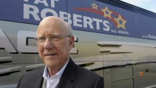Republican US Senator Pat Roberts stands outside his campaign bus after a rally in Paola, Kansas 11 October 2014