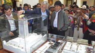 "President Evo Morales is shown the model for the ""Big House of the People"" 31 Oct 2014"
