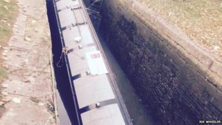 Sunken boat in canal