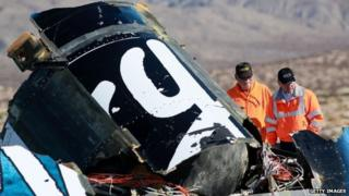 Sheriff's deputies inspect the wreckage of the Virgin Galactic SpaceShip 2 in a desert field November 2, 2014 north of Mojave, California