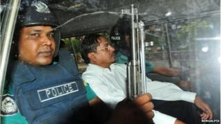 Mohammad Kamaruzzaman deputy head of the Jamaat-e-Islami Political Party being driven either to or from Dhaka Court.
