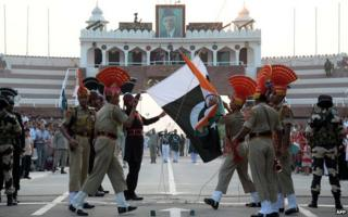 Indian and Pakistani soldiers participate in the ceremony on the Wagah border