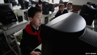 Primary school children using PC
