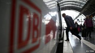Passenger stepping onto Deutsche Bahn train