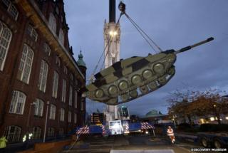 The tank is lowered into place