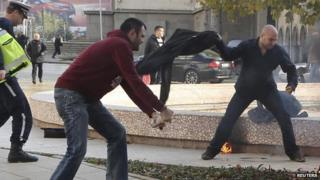 Bystanders try to save woman ablaze in Sofia, 3 Nov 14