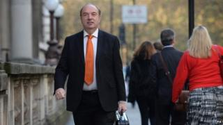 Norman Baker walking to the Lib Dem office in central London after his resignation