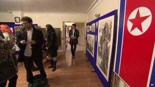 A North Korean flag hangs from the wall at a public art exhibition at the North Korean embassy