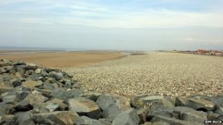 Looking across the sea wall towards Kinmel Bay