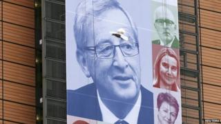 An image of the European Commission's new President Jean-Claude Juncker, on the facade of the European Commission headquarters in Brussels (4 November 2014)