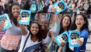Girls holding The Fault in our stars books