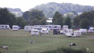 Travellers in a field