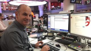The BBC's home affairs correspondent Danny Shaw in front of the desk and replies to questions by UGC.