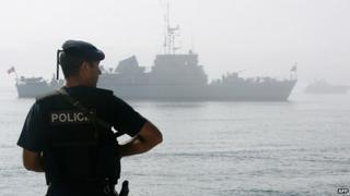 Portuguese warship and policeman - archive pic
