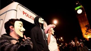Members of activist group Anonymous during a protest in Parliament Square